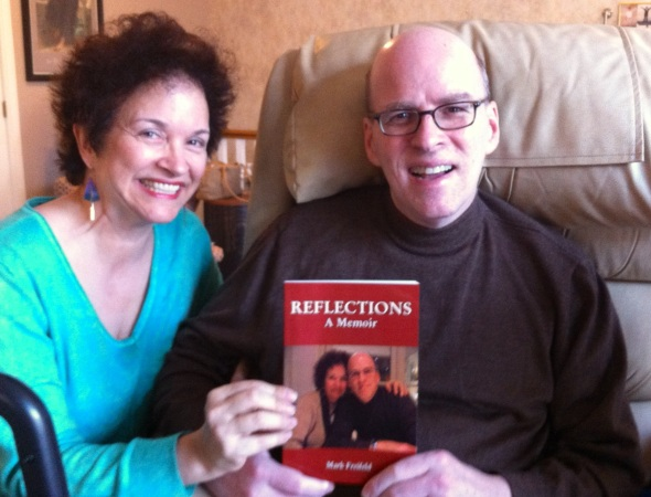 Mark and Julia proudly holding Mark's memoirs, available on Amazon.